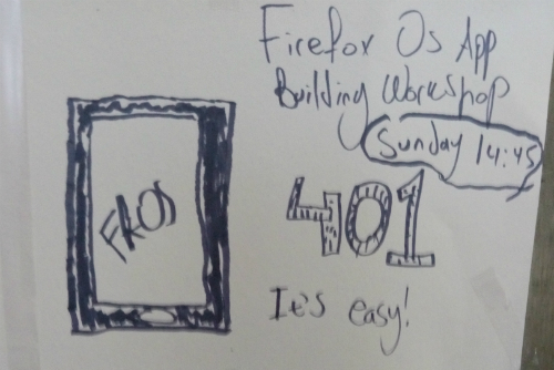 "A poster for the session I ran at Mozfest. On the left, there is a drawing of a smart phone with ""ffOS"" written on the screen. On the right, the phrase ""Firefox OS app-building workshop - Sunday 14:45 at 401. It's easy!"" is written."
